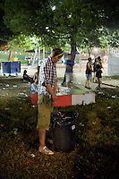 BENIC&Agrave;SSIM, SPAIN - A drunk English festival goer pees in a dustbin at the Festival Internacional de Benic&agrave;ssim...Described by some as a Mediterranean Glastonbury, the Festival Internacional de Benic&agrave;ssim (FIB) is the largest music festival outside the UK to target British visitors. In 2010, seven of the eight main headline slots were filled by English bands...A small coastal town of 13,000 inhabitants, Benic&agrave;ssim hosted some 200,000 visitors in 2009, with 40% of those believed to be coming from the UK. In 2010, attendances fell to 127,000 visitors but the percentage of UK visitors is believed to have risen.