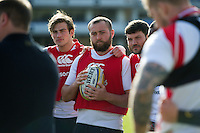 Tom Dunn of Bath Rugby looks on in a huddle. Bath Rugby Captain's Run on February 19, 2016 at the Recreation Ground in Bath, England. Photo by: Patrick Khachfe / Onside Images