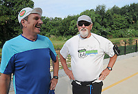 NWA Democrat-Gazette/FLIP PUTTHOFF<br /> Ross Hinshaw (left) ran part of the Razorback Greenway with his buddy, Les Garrett. Garrett enjoys cycling, but Hinshaw's inspiration has rekindled Garrett's interest in running. The pair are seen here in August 2015 on the Greenway near downtown Springdale.