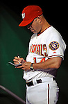 11 July 2008: Washington Nationals' Manager  Manny Acta takes notes in the dugout during a game against the Houston Astros at Nationals Park in Washington, DC. The Nationals shut out the Astros 10-0 in the first game of their 3-game series...Mandatory Photo Credit: Ed Wolfstein Photo