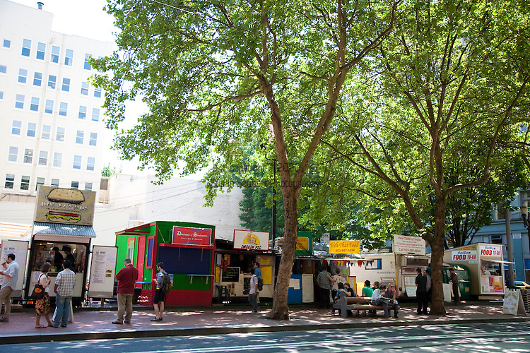 The food carts on SW 5th Ave. in downtown Portland, Oregon offer cheap, fast lunch options with ethnic food choices ranging from Indian to Czec to American burgers.