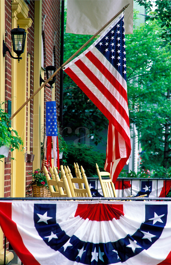 USA flag displayed on  porch with buntin