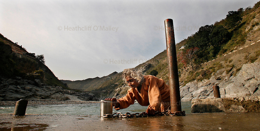 """Hindus at one of the """"ghats"""" or steps doown to the riverside to collect water and worship in the town of Devprayag a centre for pilrimage in the foothills of the Himalayas,and the confluence of Bhagirathia and Alaknanda tributaries, where the great river Ganges starts..The Ganges is 1557 miles long and stretches from the Himalayas to the Indian Port of Calcutta supplying water to one twelth of the worlds population. .  The Ganges is worshipped by the Hindu faith and is believed to be not only a source of life but also able to wash one's sins away, and Hindu's from across the globe make pilgrimage to the river referring to it as Ma Ganga."""