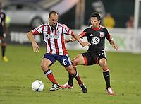 Chivas USA midfielder Peter Vagenas (6) goes against D.C. United midfielder Marcelo Saragosa (11)  D.C. United defeated Chivas USA 1-0 at RFK Stadium, Sunday September 23, 2012.