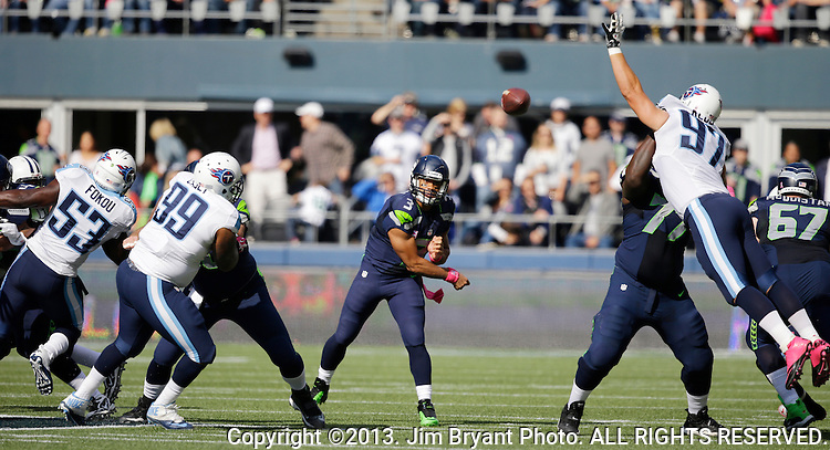 Seattle Seahawks quarterback Russell Wilson passes against the Tennessee Titians at CenturyLink Field in Seattle, Washington on  October 13, 2013. The Seattle Seahawks beat the Titians  20-13.   ©2013. Jim Bryant Photo. All Rights Reserved.