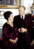 United States President Gerald R. Ford, right, speaks with Ambassador Shirley Temple Black, left, after she was sworn-in as White House Chief of Protocol at the White House in Washington, D.C. on Tuesday, July 20, 1976..Credit: Barry Soorenko / CNP