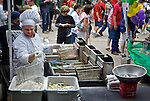 .The Taste of Madison on the Capitol Square in Madison showcases 80 restaurants giving people a chance to sample the different foods from the Madison area. The event which is held every Labor Day weekend also includes music from a number of different stages.  These vendors were photographed Sunday September 4, 2011.