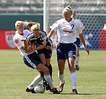 27 June 2004: Amanda Cromwell (center) is squeezed off the ball by Jennifer Tietjen-Prozzo (left) and Anne Makinen (7). The Philadelphia Charge defeated the San Jose CyberRays 2-0 at the Home Depot Center in Carson, CA in Womens United Soccer Association soccer game featuring guest players from other teams.