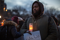 NEW YORK,NY December 16,2016: A man holds a candle   during a vigil to protest against the Syrian government and the killing of innocent people in Washington Square Park, in New York City, December  16,2016. Photo by VIEWpress/Maite H. Mateo