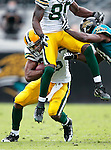 Green Bay Packers' Ryan Grant rushes for 9-yards in the 3rd quarter. Donald Driver was blocked into Grant by Jacksonville Jaguars' Drayton Florence..The Green Bay Packers traveled to Jacksonville Municipal Stadium in Florida to play the Jaguars Sunday December 14, 2008. Steve Apps-State Journal.