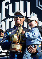 Feb. 22, 2010; Chandler, AZ, USA; NHRA funny car driver Jack Beckman celebrates with son Jason Beckman after winning the Arizona Nationals at Firebird International Raceway. The race is being run Monday after weather and darkness led to the cancellation of Sunday race action. Mandatory Credit: Mark J. Rebilas-
