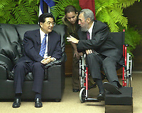 Cuban President Fidel Castro, (d) talks with Chinese President Hu Jintao, who performs a two-day official visit to Cuba. China and Cuba signed 16 economic agreements between the two countries. November 22, 2004. Credit: Jorge Rey/MediaPunch