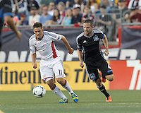 New England Revolution midfielder Kelyn Rowe (11) brings the ball forward as San Jose Earthquakes midfielder Sam Cronin (4) closes. In a Major League Soccer (MLS) match, the New England Revolution (white) defeated San Jose Earthquakes (black), 2-0, at Gillette Stadium on July 6, 2013.