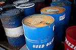 Containers of used oil line the floor of the hazardous waste storage facility at Auburn University in Auburn, Alabama November 18, 2009. Thomas Hodges leads the hazardous materials program.