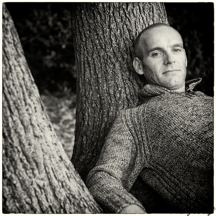 Mark leaning against a tree in the New Forest.