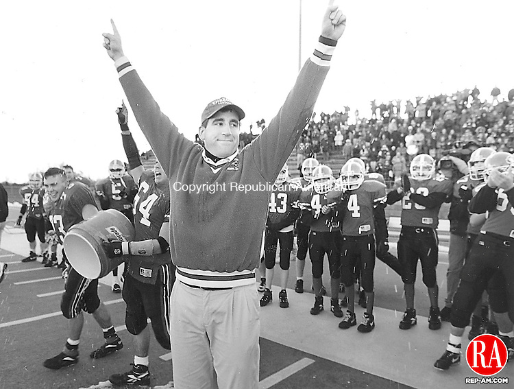 Decemeber 2, 1995 - CHESHIRE - Cheshire Coach Mark Ecke raises his hands as Cheshire claims it's fourth title. Republican-American Archives