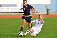 Lauren Cheney evades the tackle of an Icelandic defender. The USWNT defeated Iceland (2-0) at Vila Real Sto. Antonio in their opener of the 2010 Algarve Cup on February 24, 2010.