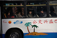 People ride a bus in Urumqi, Xinjiang, China.