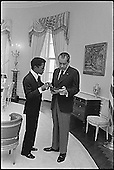 United States President Richard M. Nixon meets entertainer Sammy Davis, Jr. in the Oval Office of the White House in Washington, D.C. on March 4, 1973..Credit: The White House via CNP