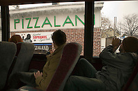 12 March 2006 - New Jersey, USA - Participants in a bus tour of locations featured in the hit television mob show The Sopranos look out at a pizza restaurant that appears in the credits of the series, in New Jersey, USA, 12 March 2006.