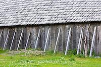 Historic viking longhouse reconstruction with oak shingles roof at Ribe Viking Center, heritage centre in South Jutland, Denmark