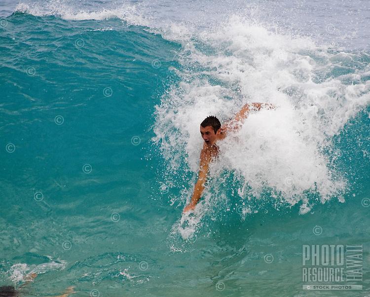 Body surfer at Sandy Beach, Oahu's favorite bodysurfing spot