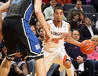 Feb. 16, 2011; Charlottesville, VA, USA; Virginia Cavaliers guard Mustapha Farrakhan (2) drives past Duke Blue Devils forward Mason Plumlee (5) during the second half of the game at the John Paul Jones Arena. The Duke Blue Devils won 56-41. Credit Image: © Andrew Shurtleff