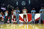 18 December 2013: Texas players and UNC cheerleaders help hold a court sized American Flag. The University of North Carolina Tar Heels played the University of Texas Longhorns at the Dean E. Smith Center in Chapel Hill, North Carolina in a 2013-14 NCAA Division I Men's Basketball game.
