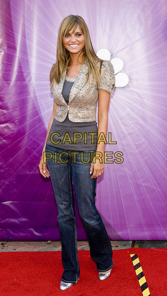 HEIDI MUELLER.Network All Star Celebration held at the Century Club, .Los Angeles, 25th July 2005.full length full-length grey gray top jacket metallic silver shoes denim jeans .www.capitalpictures.com.sales@capitalpictures.com.© Capital Pictures.