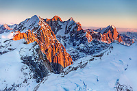 Winter landscape of first light on Mt. Dickey, Moose's Tooth, Bear Tooth and Broken Tooth with glaciers and other Alaska Range Mountains. Denali National Park, Alaska<br /> <br /> Photo by Jeff Schultz/SchultzPhoto.com  (C) 2017  ALL RIGHTS RESVERVED