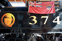 Canadian Red Ensign flag on the side of restored CPR Engine 374 at the Roundhouse  in Yaletown, Vancouver, British Columbia, Canada. On May 23, 1887 this steam engine pulled the first transcontinental train into Vancouver.