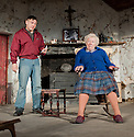 "London, UK. 22/07/2011. ""The Beauty Queen of Leenane"" by Martin McDonaugh returns to the Young Vic. Johnny Ward as Ray Dooley and Rosaleen Linehan as Mag Folan. Photo credit: Jane Hobson"