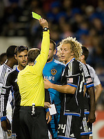 Referee Kevin Scott gives a yellow card to Steven Lenhart of Earthquakes during the game against LA Galaxy at Buck Shaw Stadium in Santa Clara, California on November 7th, 2012.   LA Galaxy defeated San Jose Earthquakes, 3-1.