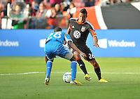 Lionard Pajoy (26) of D.C. United goes against Raymon Gaddis (28) of the Philadelphia Union. The Philadelphia Union defeated D.C. United 3-2, at RFK Stadium, Sunday April 21, 2013.