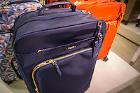 Tumi brand luggage in a Tumi store in New York on Friday, March 4, 2016. Samsonite announced that it has agreed to buy competitor Tumi in a deal worth approximately $1.8 billion. The acquisition provides an entry for Samsonite into the world of expensive, high-end luggage. (© Richard B. Levine)