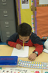 Oakland CA 2nd grader comically pretending to do his writing project without hands
