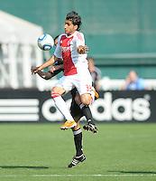 AFC Ajax forward Aras Ozbiliz (33) jumps to shield the ball.   AFC Ajax defeated DC United 2-1 during an International Friendly at RFK Stadium Sunday May 22, 2011.