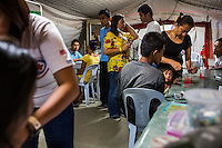 Survivors of the Zamboanga City rebel attack taking refuge in the city's largest stadium receive medical attention in the Emergency Response tent in Zamboanga, Mindanao, The Philippines on November 4, 2013. These Internally Displaced People (IDP) had taken refuge in the main stadium after surviving the 3 week long attack by MNLF rebels. Photo by Suzanne Lee for SPRINT-IPPF