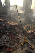 Ground Zero, New York City, N.Y. - Sept. 16, 2001 -- A view of the crime scene where the World Trade Center collapsed following the September 11, 2001 terrorist attack on September 16, 2001.  Surrounding buildings were heavily damaged by the debris and massive force of the falling twin towers.  Clean-up efforts are expected to continue for months.  .Credit: Aaron Peterson - US Navy via CNP