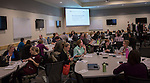 Attendees of the Marketing Symposium ask each other questions to get to know one another during the Discovering Common Ground icebreaker on November 4, 2015 in Schoonover Center. Photo by Emily Matthews