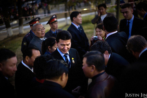 Kirsan Ilyumzhinov, 44, president of the southern Russian republic Kalmykia, stands among a crowd of officials in the provincial capital, Elista. ..Ilyumzhinov, who is also the president of the World Chess Federation, Fide, is hosting one of the world?s most important matches in history. ..The match beginning September 21 in Elista, the capital of Europe?s only Buddhist nation, will end a 13-year split in the game that has produced rival claims to the title. ..Veselin Topalov, a Bulgarian ranked first according to Fide, will play against Vladimir Kramnik, who is the Classical Chess World Champion, a title established after Garry Kasparov led a breakaway from Fide in 1993. The two grandmasters, both aged 31, will face each other for the right to be undisputed world chess champion...A Buddhist millionaire businessman, Ilyumzhinov acquired his wealth in the economic free-for-all which followed the collapse of the Soviet Union. ..At the age of just over 30, he was elected president in 1993 after promising voters $100 each and a mobile phone for every shepherd. Soon after, he introduced presidential rule, concentrating power in his own hands. ..He denies persistent accusations of corruption, human rights abuses and the suppression of media freedom. When Larisa Yudina, editor of the republic's only opposition newspaper and one of his harshest critics, was murdered in 1998, he strenuously rejected allegations of involvement. ..Mr Ilyumzhinov has been president of the International Chess Federation (FIDE) since 1995 and has been enthusiastic about attracting international tournaments to Kalmykia. His extravagant Chess City has led to protests by its impoverished citizens. .