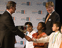 Mexican President Vicente Fox shakes hands with a boy as Dutch Crown Prince Willem Alexander during the opening of the IV World Water Forum in Mexico City, March 16. 2006.  Over ten thousand representatives of 120 countries are attending the meeting to discuss water issues. Photo by Javier Rodriguez © Javier Rodriguez