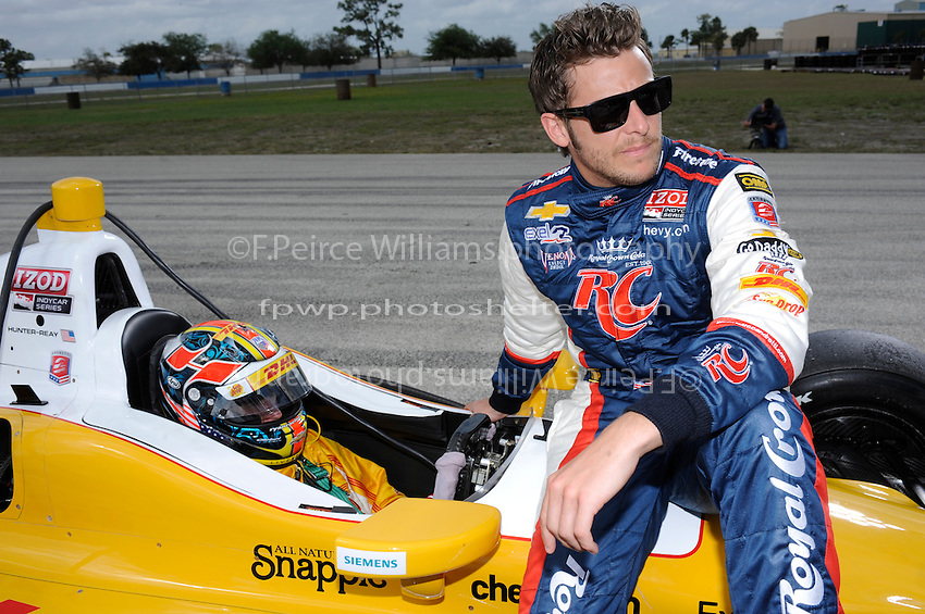 Marco Andretti (#26) talks with teammate Ryan Hunter-Reay (#28) during a break in practice.