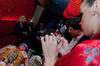 Guestt akes photos of a sushi table served on the body of a naked woman following japanese traditions in a club in downtown Budapest, Hungary on September 23, 2011. ATTILA VOLGYI