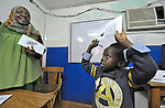 Refugee boy in class in a school operated by St. Andrew's Refugee Services in Cairo, Egypt. The school is supported by Church World Service.