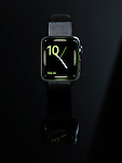 Shiny steel Apple Watch stylish smartwatch with analog clock dial on display isolated on black background