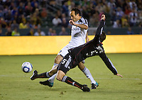 DC United defender Dejan Jakovic applies a tackle on LA Galaxy midfielder Landon Donovan. The LA Galaxy defeated DC United 2-1at Home Depot Center stadium in Carson, California on Saturday September 18, 2010.