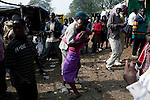 LUDZIDZINI, SWAZILAND - AUGUST 30: A young woman dances with an older boy during a traditional Reed dance ceremony at the stadium at the Royal Palace on August 30, 2009, in Ludzidzini, Swaziland. About 80.000 virgins from all over the country attended this yearly event, which goes on for a week and the biggest in Swazi culture. It was founded to celebrate the beauty of Swazi women and girls. King Mswati III, and absolute monarch, was born in 1968 and he has 14 wives and many children. The king danced with his men in front of the 80.000 girls. Many of the girls hope to get noticed by the king and to be chosen as a future wife, a ticket from poverty and into a life of privilege and luxury. The country is one of the poorest in the world and it is struggling with a high prevalence of HIV-Aids and severe poverty. (Photo by: Per-Anders Pettersson)...