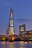 Night image of the Shard which is situated at London Bridge station next to the Thames. This image was taken in December 2011. On completion this will be the highest building in Europe at 310 metres (1,017 feet)310 metres (1,017 feet) The Opening of the Shard is on the 5th of June 2012. <br />