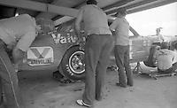 crewmwn work on A.J. Foyt 14 Oldsmobile in garage Firecracker 400 at Daytona International Speedway in Daytona Beach, FL on July 4, 1983. (Photo by Brian Cleary/www.bcpix.com)